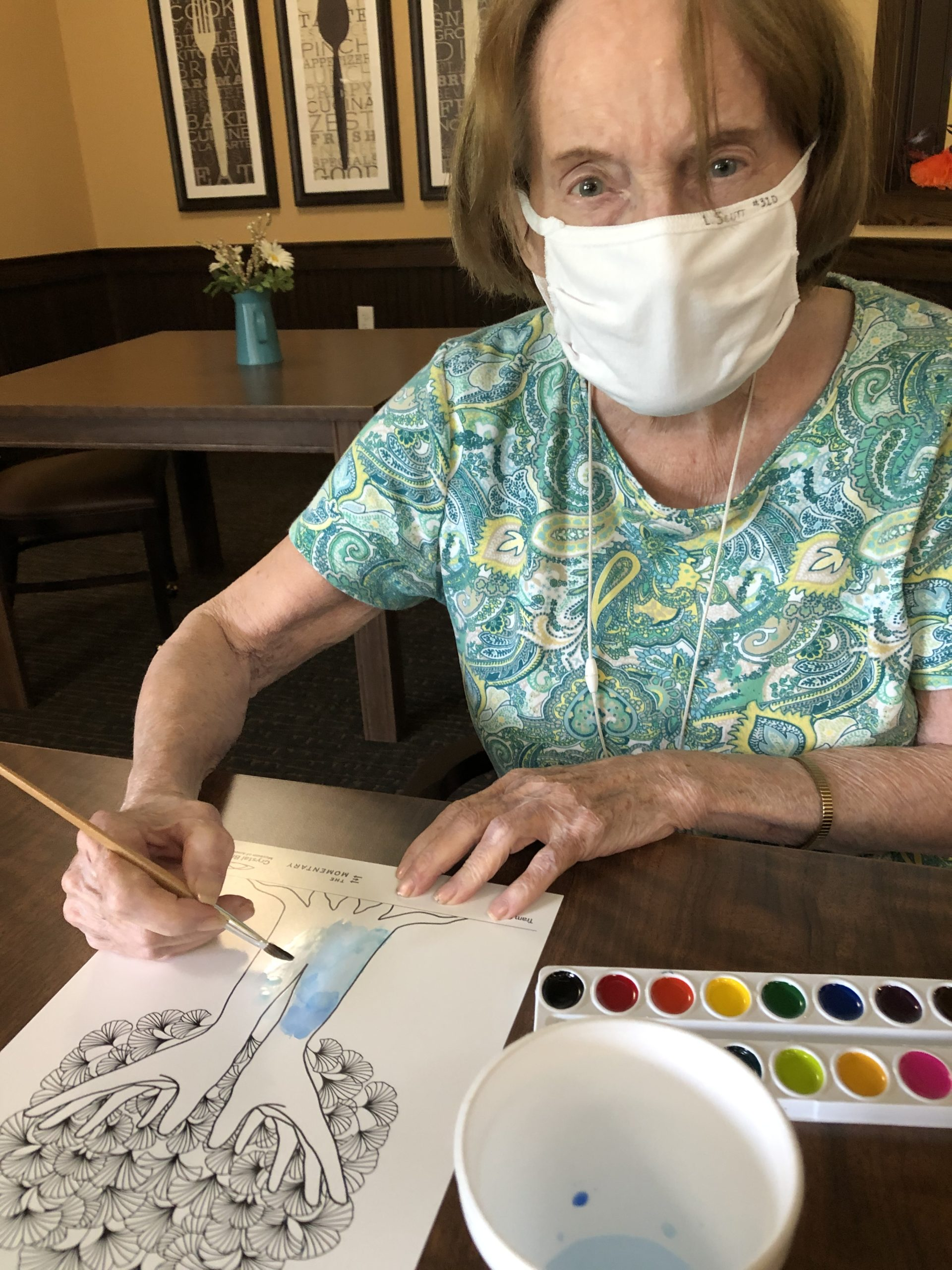 Laurel enjoyed water color painting the artwork that the Crystal Bridges Museum of Art donated to our Primrose residents.