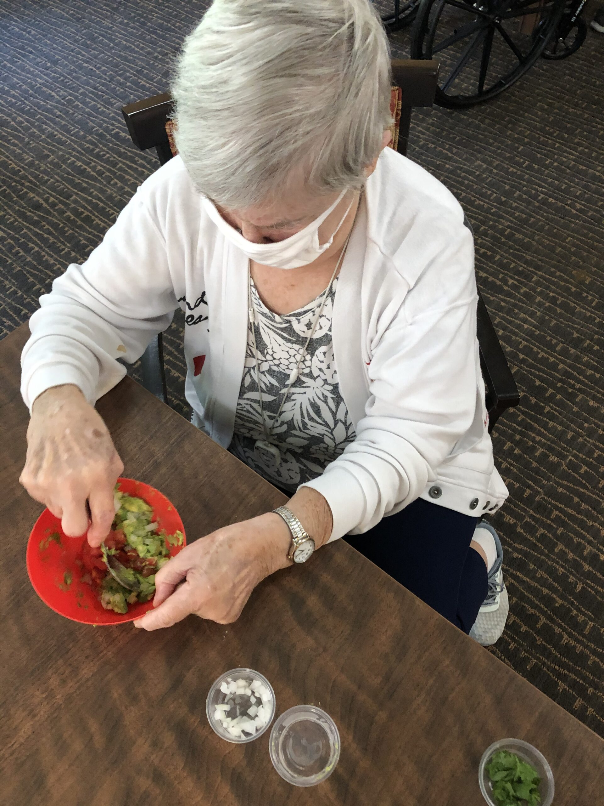For cooking class this week we made Guacamole! Marilyn had never had it before and wasn't so sure she would like it... one bite in and she exclaimed,