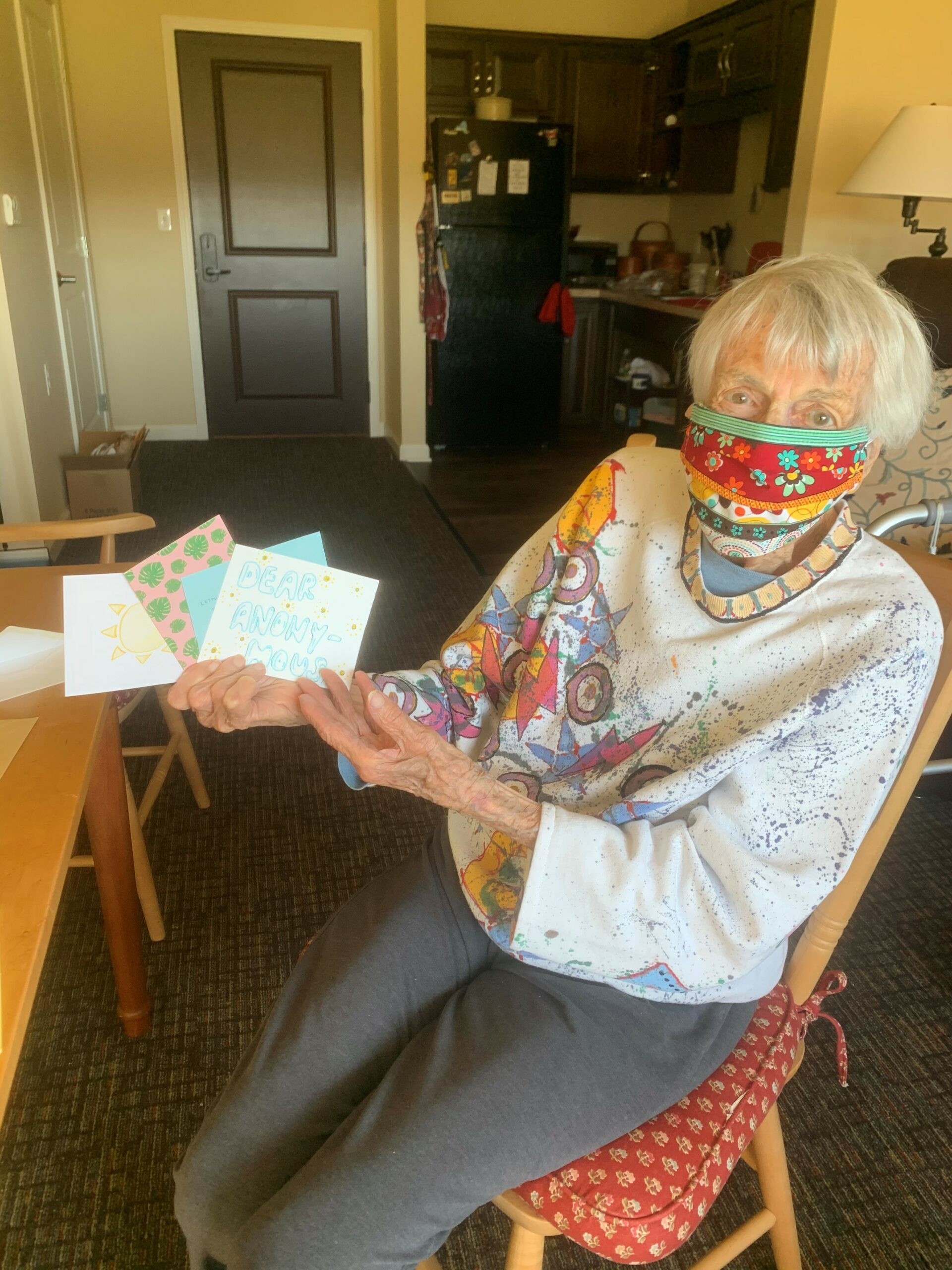 Letters of Love Encouraging Cards for Residents- Anne proudly holds up the greeting cards she received from the group Letters of Love. It is a group that collects cards from all over the US and sends them to retirement residents to uplift their spirits and let them know how much they are cared about!