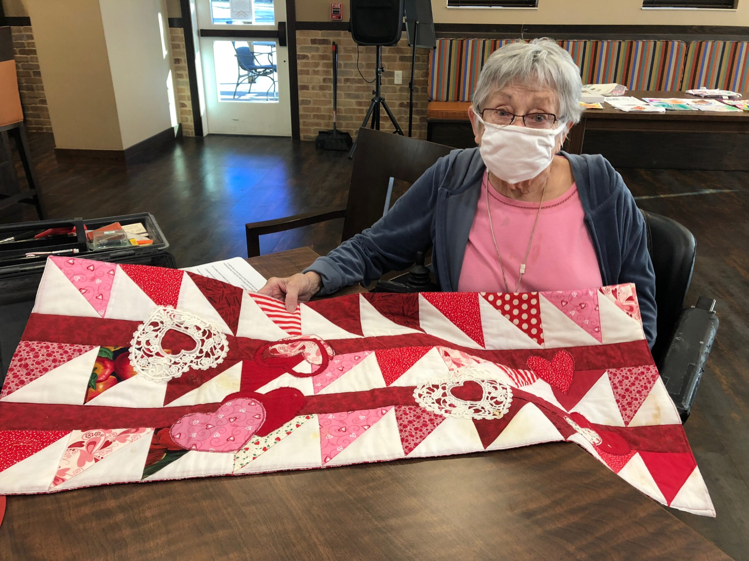 Juanita's Heart Quilt- Residents gathered to do a fun craft day of drawing on Heart Shaped Rainbow Scratch Paper. During the craft, Juanita brought down her Heart Quilt she had made to inspire other's to have fun with their art and creativity that they do!