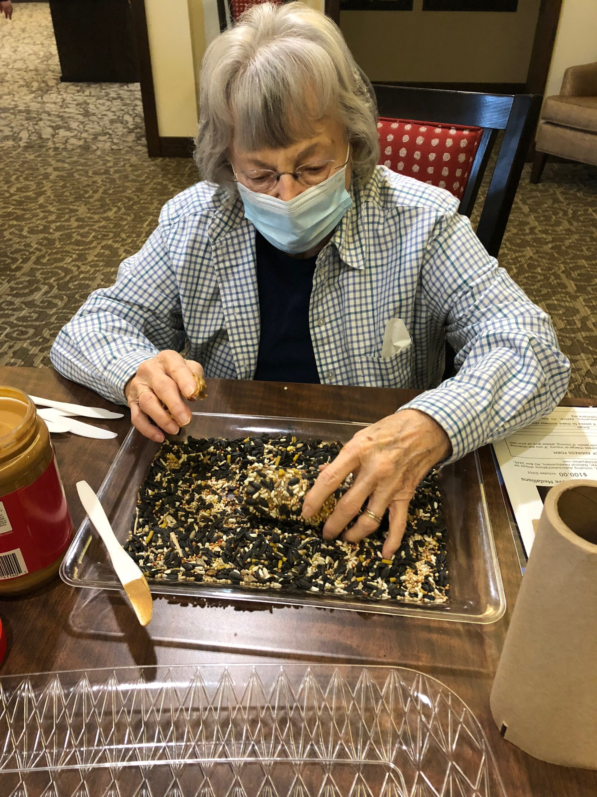 Bird Seed Feeder Craft Day- Jean had a blast getting her hands messy while creating peanut butter and bird seed feeders for our Primrose Birds to enjoy!