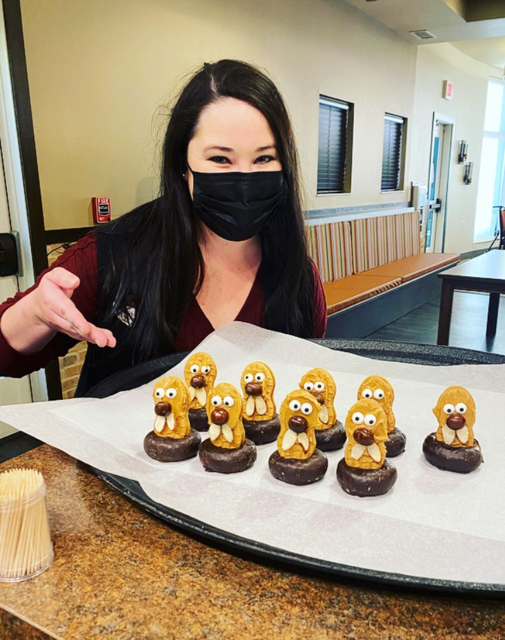 Having Fun on Groundhog Day!- Life Enrichment Coordinator, Lindsay shows off the edible groundhogs made by the Primrose residents! Residents also watched the movie Groundhog Day and went on a scavenger hunt to find groundhogs all around the building!