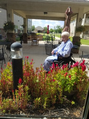One of our residents' love looking at flowers. She's one of courtyard's faithful customer.