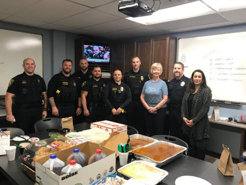 Millie with some of the officers that we delivered lunch and goody bags to for Law Enforcement Appreciation Day!