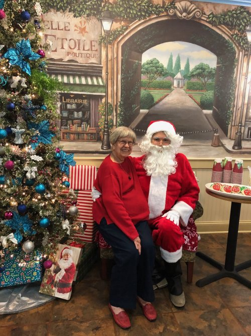 Sue telling Santa what she wants for Christmas!