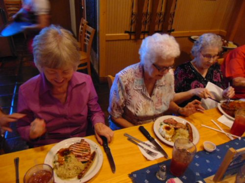 Millie and Sannie in awe over the wonderful food they are about to eat at the Royal Bavaria German restaurant.