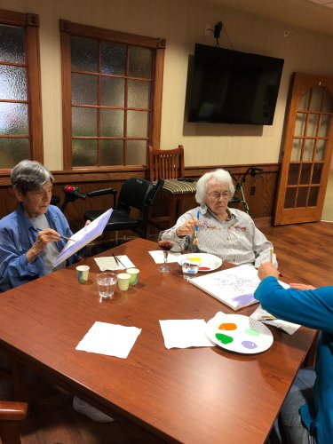 Residents painting during Arts & Crafts