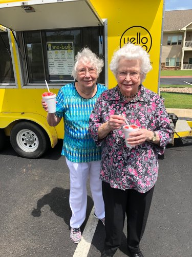 A couple of our residents enjoying a snow cone at our community block party!