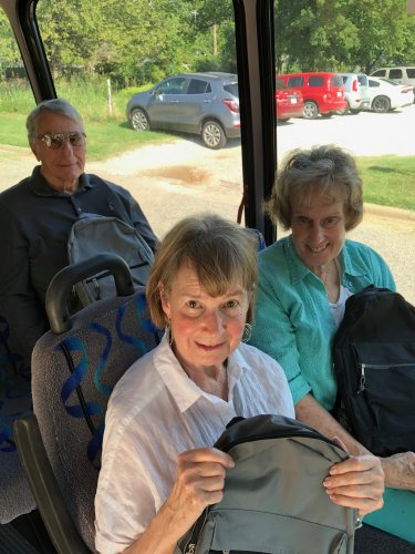 Residents delivering backpacks to a local school
