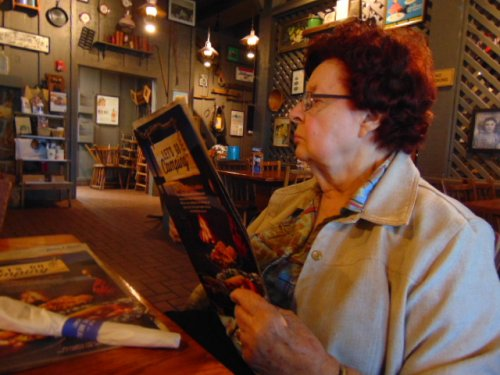 Ruth is checking out the menu at Cracker Barrel restaurant in Shawnee, OK during our dining out activity.