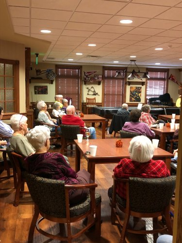 Residents listening to music during Happy Hour