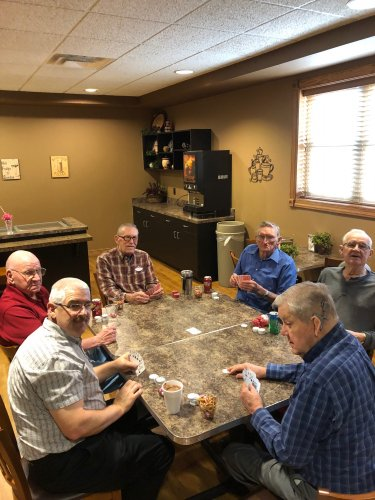 A friendly game of cards between men
