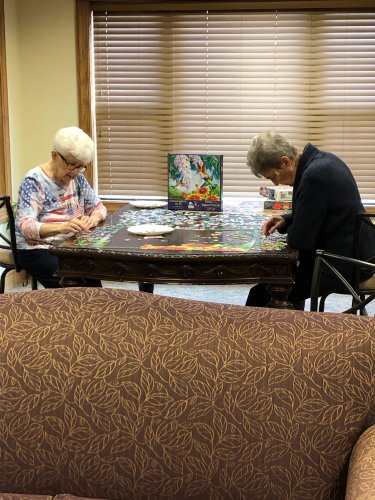 Marie and Cathy working hard on a puzzle!