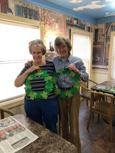 Teresa and Carol showing off their St Patrick's Day craft