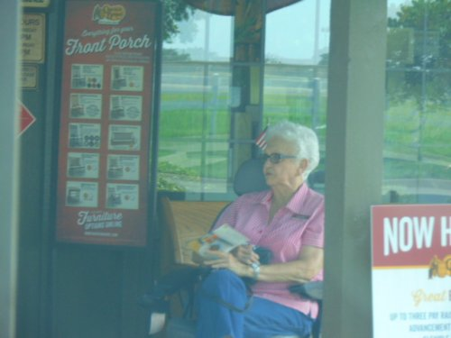 Sannie is waiting for the rest of the group to come out of the restaurant after having a super dinner at Cracker Barrel restaurant in Shawnee, OK