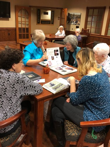 Ladies sharing about places they have traveled