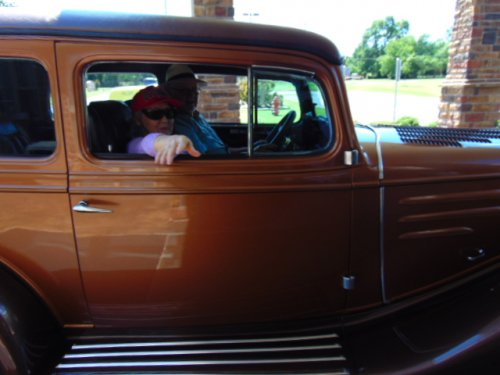Mattie is getting a ride in a 1935 Ford