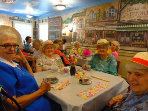 Looking pretty in their hats at the ladies tea!