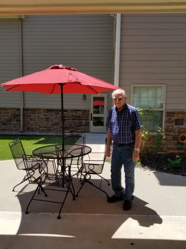 Showing off the new umbrella in the courtyard