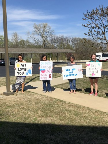 Family members made signs to encourage our residents!