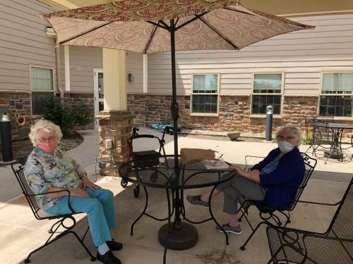 Betty and LaVada enjoying the nice weather and company outside!