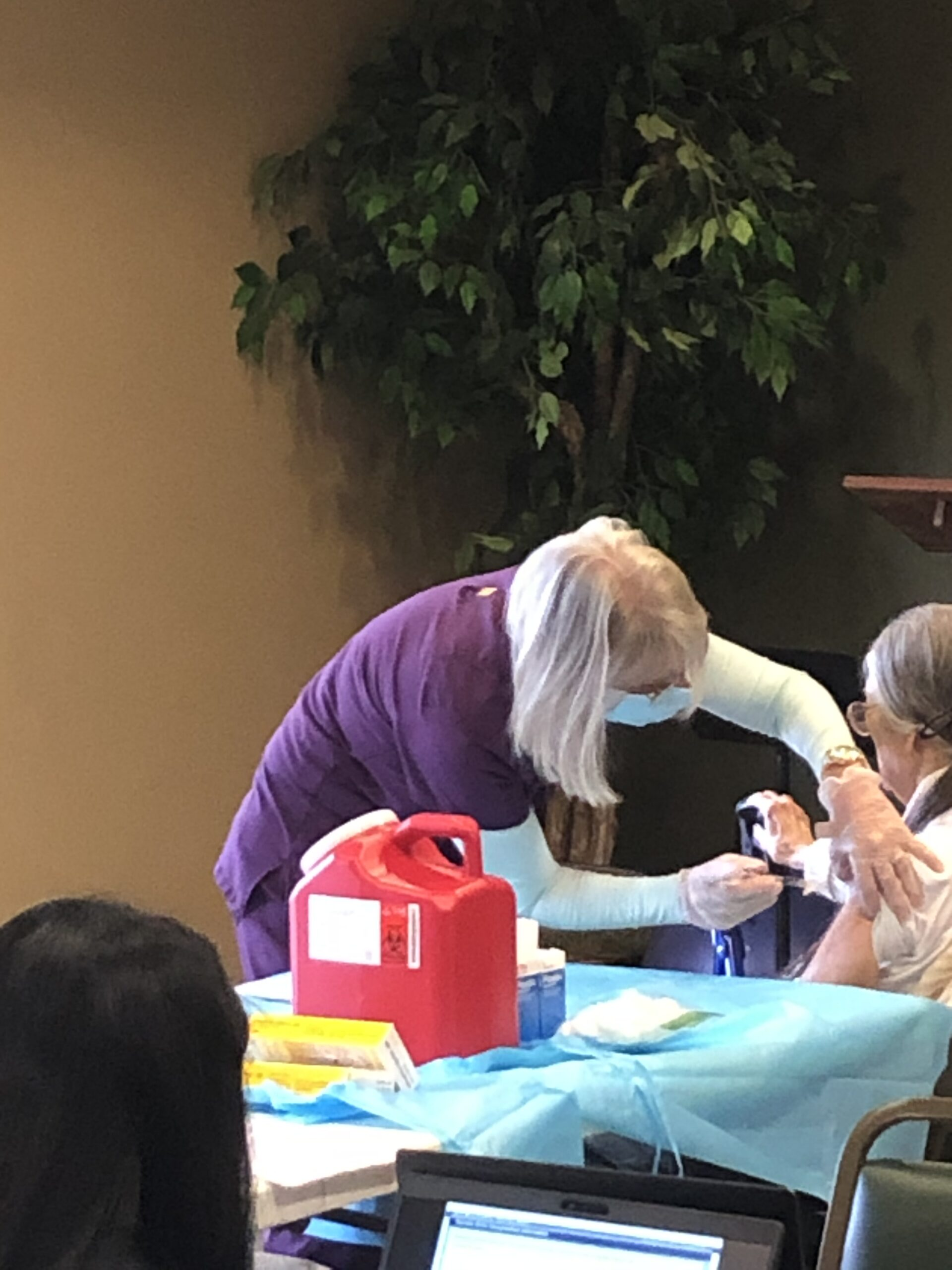 Janette getting her vaccine shot