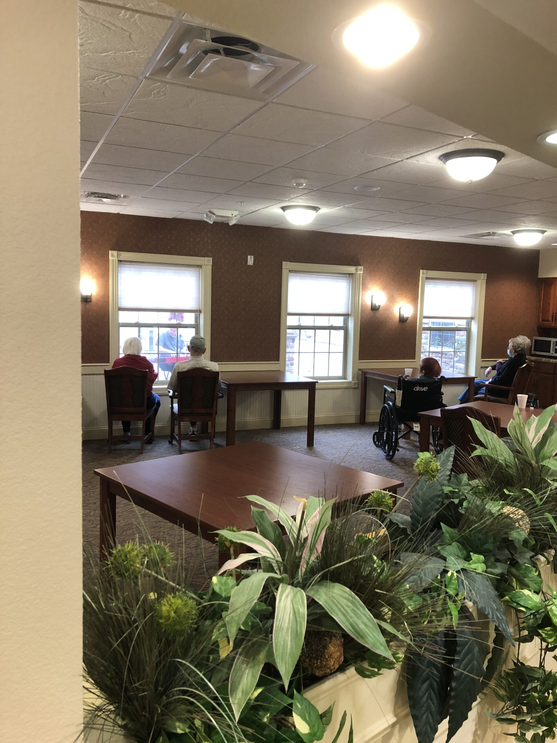 Residents listening to guest musician through the windows.