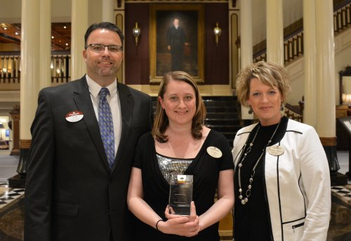 Primrose Sioux Falls Employee of the year Krista Turnwall.  She is pictured with Tom Brown and Melissa Nelson.