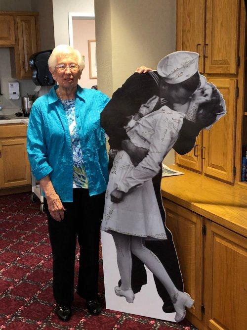 Fran showing her life size poster at Primrose Senior University!