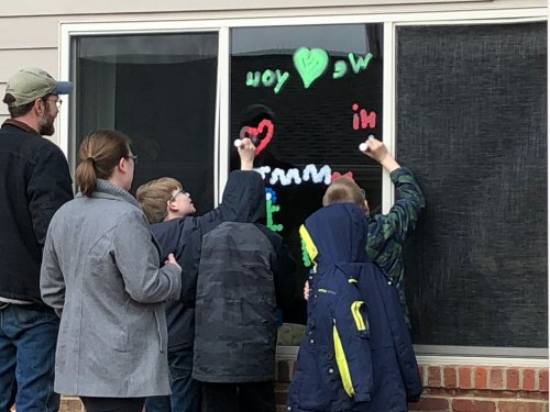 Corrine has some great grandsons!  Surprised her with some window painting!
