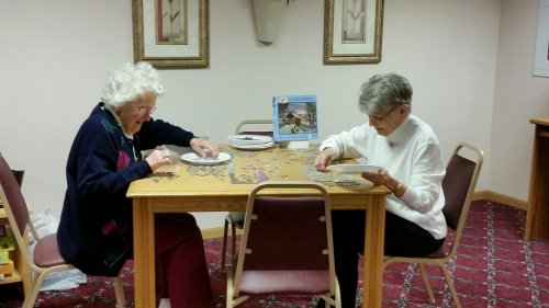 Residents like putting puzzles together.