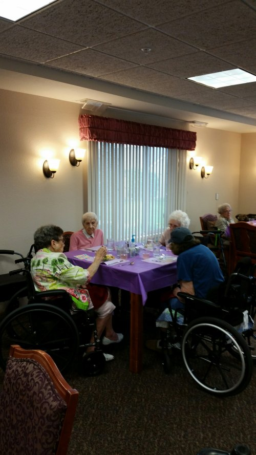 Residents enjoying some social time before the special meal for The Longest Day.