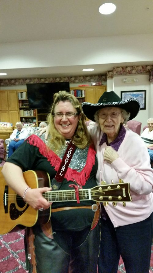 the Singing Cowgirl(Lisa Murphy)came to sing for us and she let Pat wear her cowboy hat!  What a fun night!!