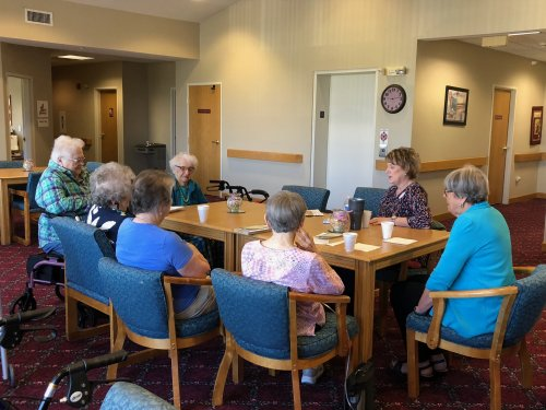 Melissa and residents having a discussion at book club!