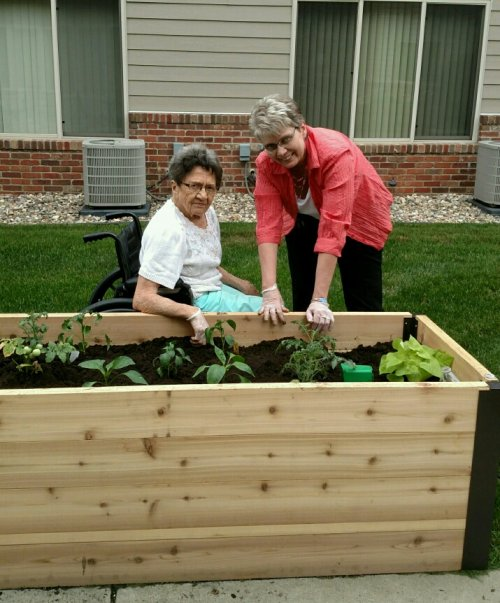 It is garden time.  Thelma and Dianne planting the vegetables.