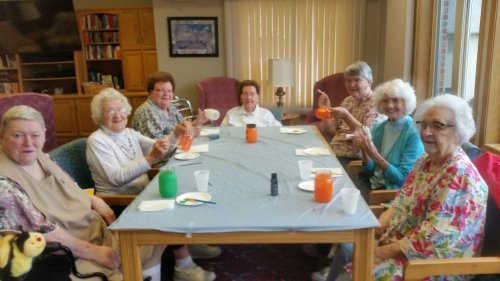 It is Halloween Craft Time!  The ladies are busy making Halloween tea lights out of mason jars.