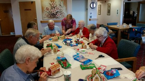Residents creating Gingerbread Houses.