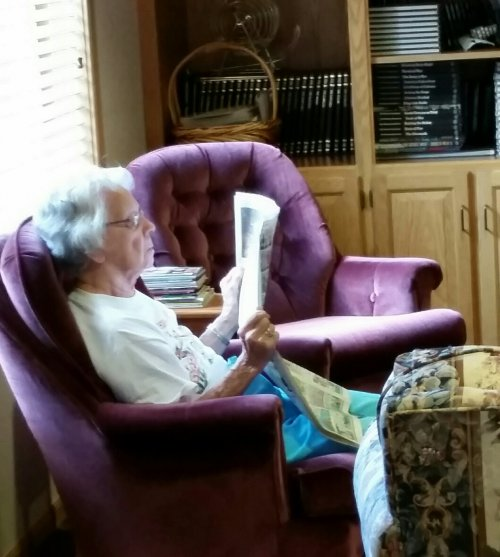 Adeline enjoying the newspaper in our fireside lounge.