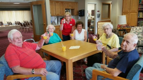 Lou celebrating Assisted Living Week with some of the residents!
