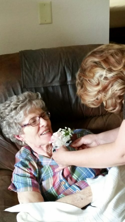 Barb Graff receiving a Mother's Day Corsage.  How pretty!