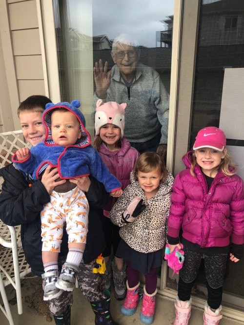 Ralph enjoying a window visit from his great grand children!