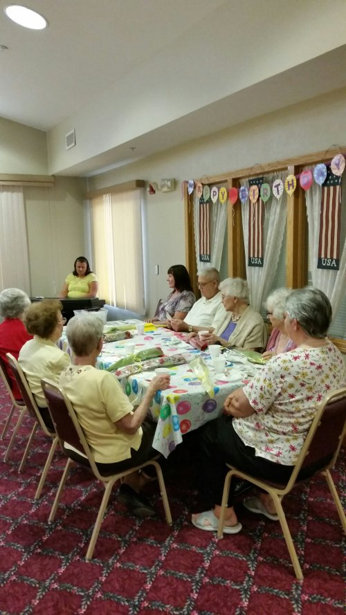 Residents enjoy piano music during the August birthday party.