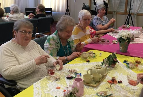 Residents enjoying the tea & homemade treats by Lou at the Spring Fling!