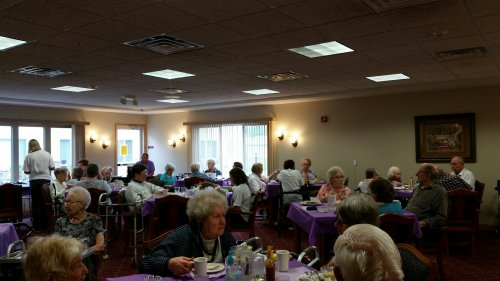 Primrose residents enjoying a special meal with music to celebrate the Longest Day Event!