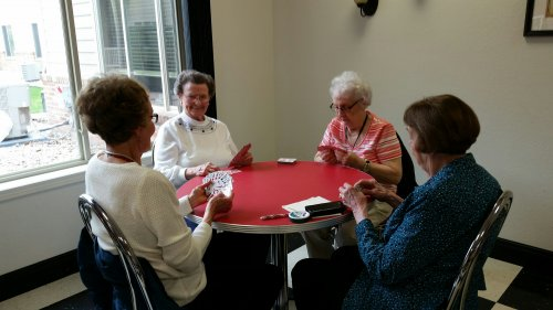 Carole, Leora, Elaine, Char spending the afternoon playing bridge.