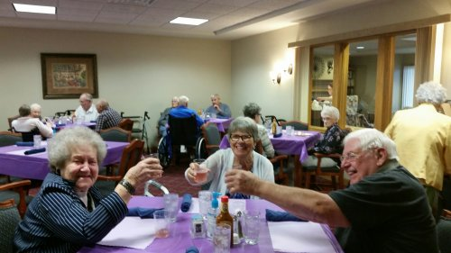 Rose Marie, Joyce and Virgil enjoying a wine spritzer and making a toast to the Longest Day!