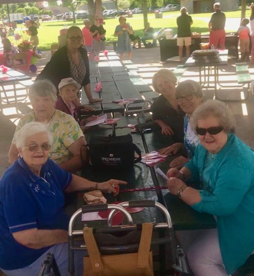Residents attend the AseraCare Hospice Butterfly event.