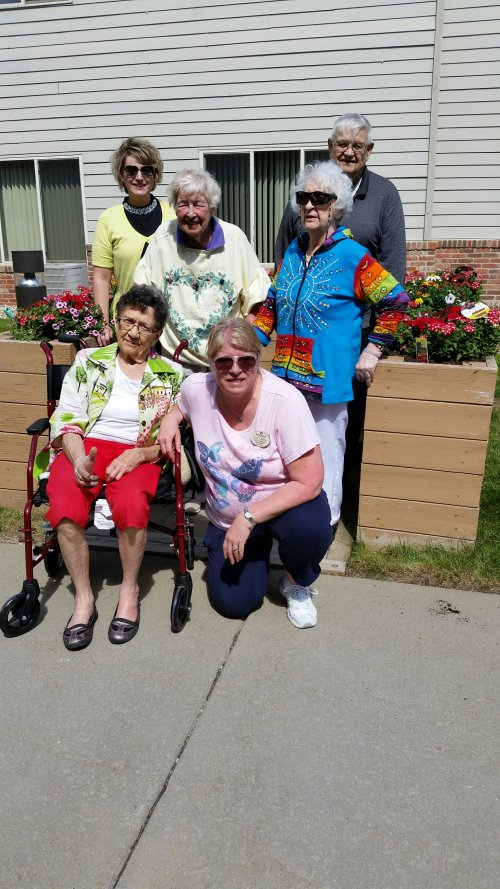 The fun group of residents and staff after finishing the flower bed.