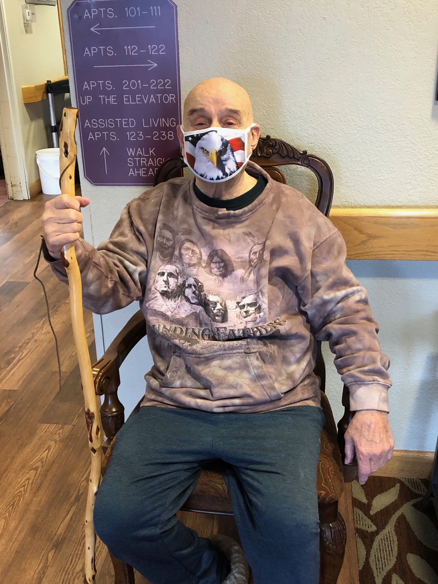 Milt taking a break from his walk with his black hills wooden walking stick!