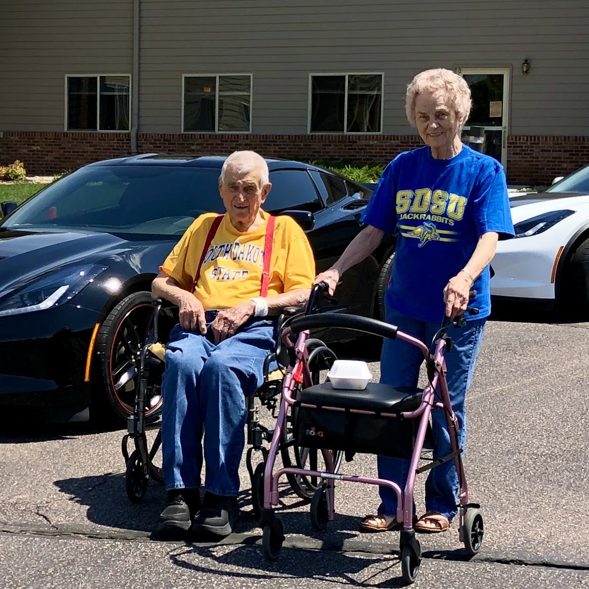 Residents enjoying the warm weather and the corvette's